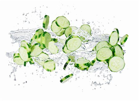 splash - Cucumber slices with a splash of water Stock Photo - Premium Royalty-Free, Code: 659-06187105