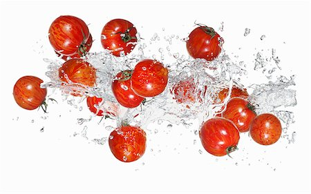 Tiger tomatoes with a water splash Stock Photo - Premium Royalty-Free, Code: 659-06187148