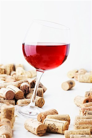 A glass of red wine with corks Stock Photo - Premium Royalty-Free, Code: 659-06187189