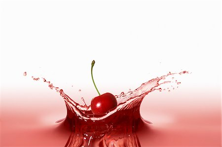 droplet - A cherry falling into red juice Stock Photo - Premium Royalty-Free, Code: 659-06187255