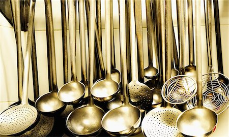 Ladles and strainer spoons in a large kitchen Stock Photo - Premium Royalty-Free, Code: 659-06187746