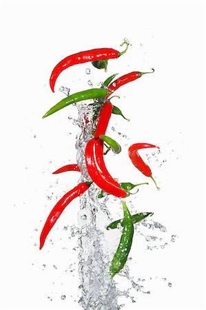 flying - Airborne chillies and water Stock Photo - Premium Royalty-Free, Code: 659-06187853