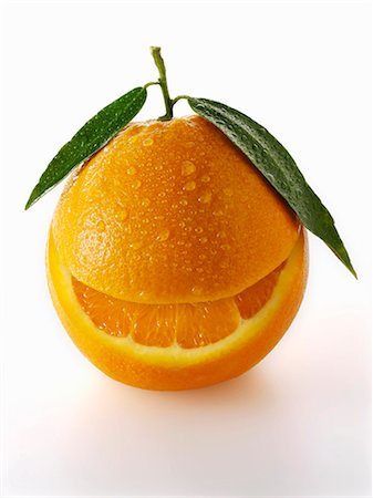 One orange with leaves and a slice taken out of it Stock Photo - Premium Royalty-Free, Code: 659-06187910
