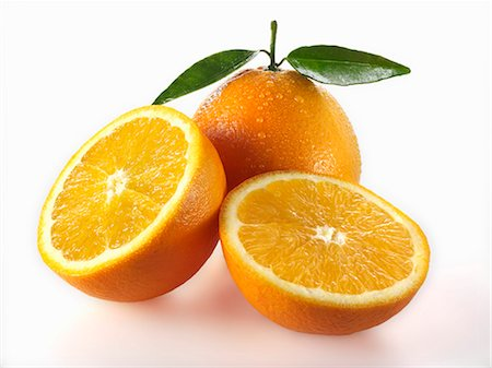 Oranges, whole and halves Stock Photo - Premium Royalty-Free, Code: 659-06187920