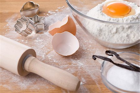 sugar - Assorted baking ingredients, cookie cutters and rolling pin Stock Photo - Premium Royalty-Free, Code: 659-06188080