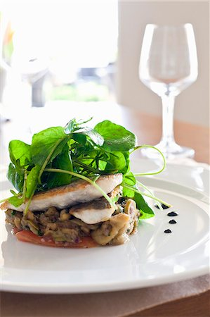 Sea bass on a bed of vegetables with water cress Stock Photo - Premium Royalty-Free, Code: 659-06188140