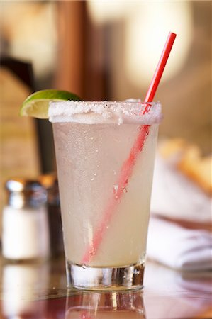 Margarita in a Glass with a Salted Rim and a Red Straw Stock Photo - Premium Royalty-Free, Code: 659-06188196
