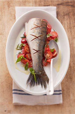 recipe - Fried fish on a bed of tomatoes Stock Photo - Premium Royalty-Free, Code: 659-06188274