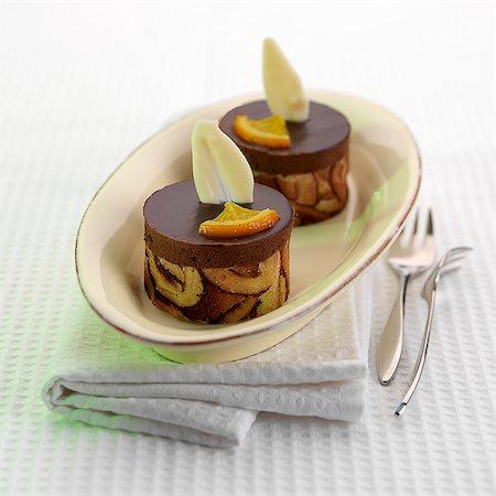 Chocolate and orange tartlets Stock Photo - Premium Royalty-Free, Code: 659-06188345