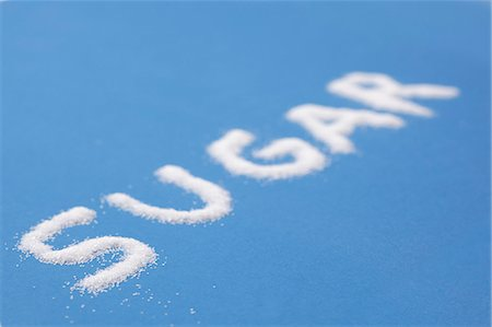 sugar - The word SUGAR written on a blue surface Stock Photo - Premium Royalty-Free, Code: 659-06188416