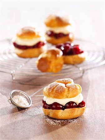 puff - Profiteroles filled with cherries and cream Stock Photo - Premium Royalty-Free, Code: 659-06188604