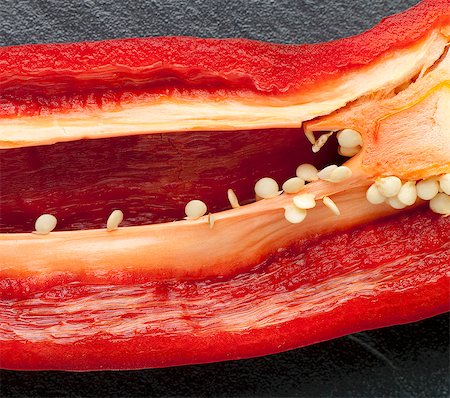 paprika - Red Pepper Sliced to Reveal Seeds and Ribs Stock Photo - Premium Royalty-Free, Code: 659-06306189