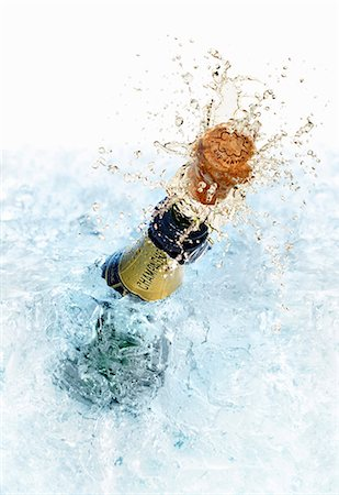 An open champagne bottle Stock Photo - Premium Royalty-Free, Code: 659-06306241