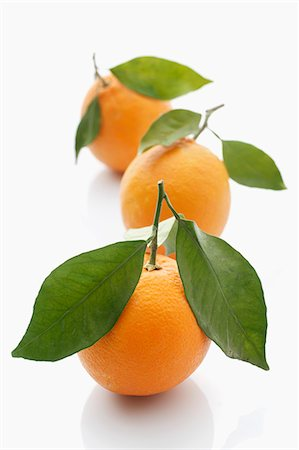 Three oranges with leaves Stock Photo - Premium Royalty-Free, Code: 659-06306537