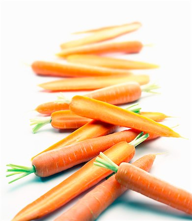 Carrots, whole and halved Stock Photo - Premium Royalty-Free, Code: 659-06306795