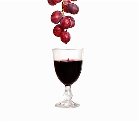dripping silhouette - Red wine dripping from red grapes into wine glass Stock Photo - Premium Royalty-Free, Code: 659-06306815