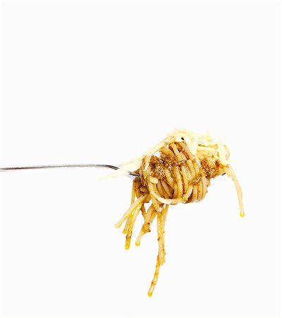 fork - A fork of spaghetti with pesto and grated cheese Stock Photo - Premium Royalty-Free, Code: 659-06306813
