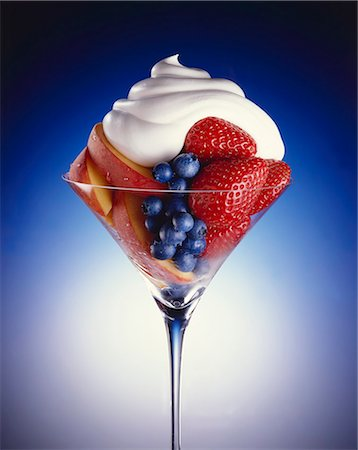 dessert - Fresh Fruit Salad in a Stem Glass Topped with Whipped Cream Stock Photo - Premium Royalty-Free, Code: 659-06307037