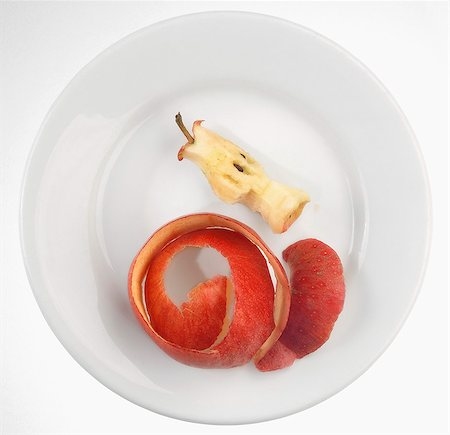 An apple core and apple peel on a plate Stock Photo - Premium Royalty-Free, Code: 659-06307181