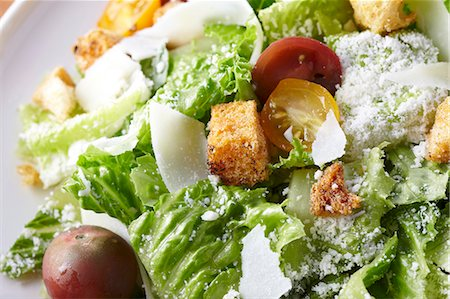 salad - Romaine Lettuce Salad with Tomatoes, Croutons and Parmesan Cheese Stock Photo - Premium Royalty-Free, Code: 659-06307190