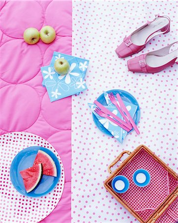femininity - A picnic basket, fruit, napkins and shoes on a rug Stock Photo - Premium Royalty-Free, Code: 659-06307301