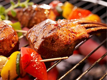 rib - Ribs and vegetables on a barbecue (close-up) Stock Photo - Premium Royalty-Free, Code: 659-06307312