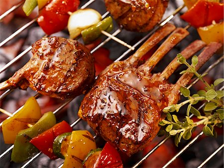 rib - Vegetable kebabs and ribs on a barbecue Stock Photo - Premium Royalty-Free, Code: 659-06307336