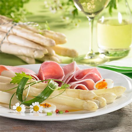 Asparagus with ham, egg and chamomile flowers and white wine Stock Photo - Premium Royalty-Free, Code: 659-06307622