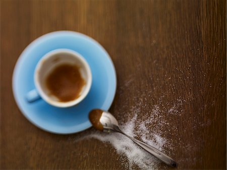 sugar - An almost-empty espresso cup and sugar sprinkled next to it Stock Photo - Premium Royalty-Free, Code: 659-06307670