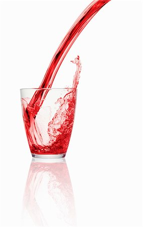 effect - A red fizzy drink being poured into a glass Stock Photo - Premium Royalty-Free, Code: 659-06307744