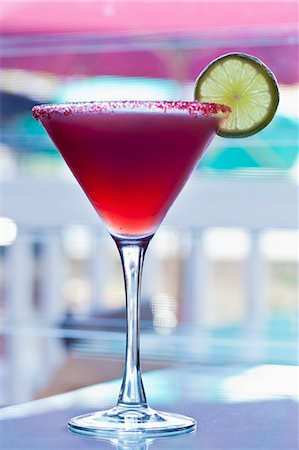 Hibiscus Infused Tequila Margarita with Sugared Rim and Lime Garnish Stock Photo - Premium Royalty-Free, Code: 659-06372328