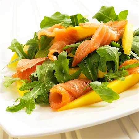 smoked - Arugula Salad with Salmon and Mango on a White Plate Stock Photo - Premium Royalty-Free, Code: 659-06372914