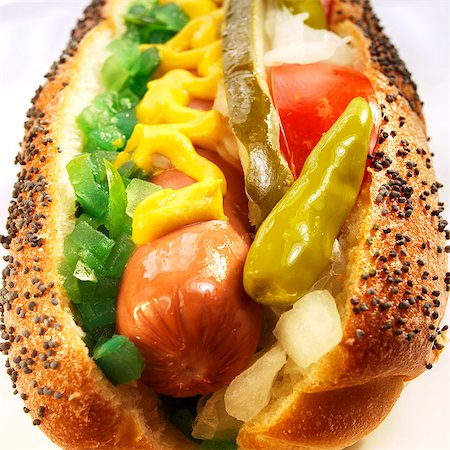 spicy - Chicago Hot Dog with Peppers, Onions and Mustard; Close Up Stock Photo - Premium Royalty-Free, Code: 659-06372935
