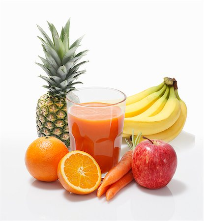 Multi-vitamin juice surrounded by whole fruits Stock Photo - Premium Royalty-Free, Code: 659-06373006