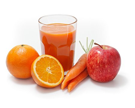 Multi-vitamin juice surrounded by oranges, apples and carrots Stock Photo - Premium Royalty-Free, Code: 659-06373009