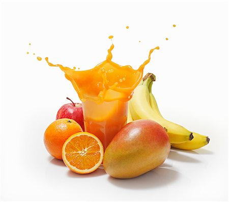 splash - A splash of juice in a glass surrounded by oranges, bananas, mango and apple Stock Photo - Premium Royalty-Free, Code: 659-06373012