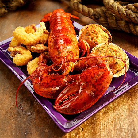 Seafood Platter with Lobster, Fried Shrimp and Stuffed Clams Stock Photo - Premium Royalty-Free, Code: 659-06373063