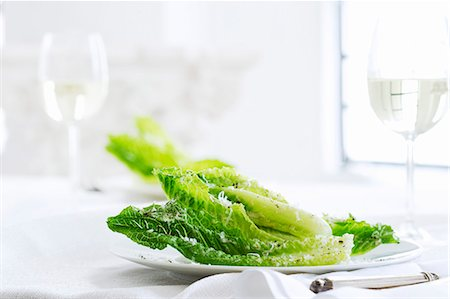 Caesar Salad with Whole Romaine Leaves Stock Photo - Premium Royalty-Free, Code: 659-06373153