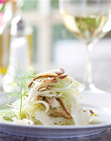 recipe - Shaved Fennel Salad on a White Plate Stock Photo - Premium Royalty-Free, Code: 659-06373266