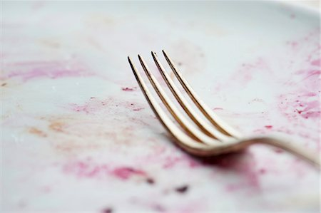 fork - A fork on a dirty plate Stock Photo - Premium Royalty-Free, Code: 659-06373322