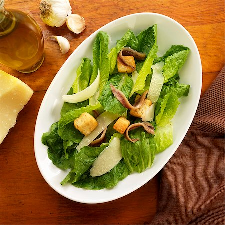 Bowl of Caesar Salad with Anchovies Stock Photo - Premium Royalty-Free, Code: 659-06373410