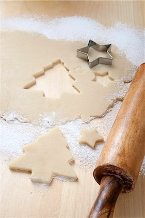 Christmas tree shapes cut out of sweet pastry Stock Photo - Premium Royalty-Free, Code: 659-06373702