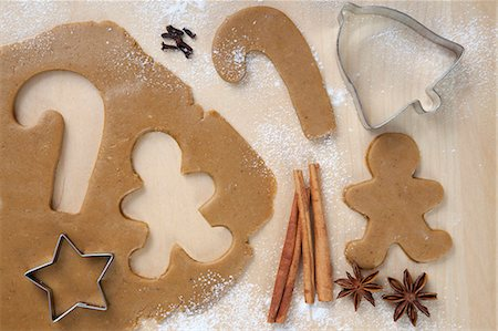 Gingerbread Man and Candy Cane Cut From Cookie Dough; Star Cookie Cutter Stock Photo - Premium Royalty-Free, Code: 659-06373703
