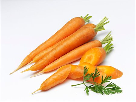 Carrots, whole and chopped Stock Photo - Premium Royalty-Free, Code: 659-06373778