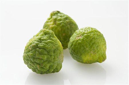 Three kafir limes Stock Photo - Premium Royalty-Free, Code: 659-06494075