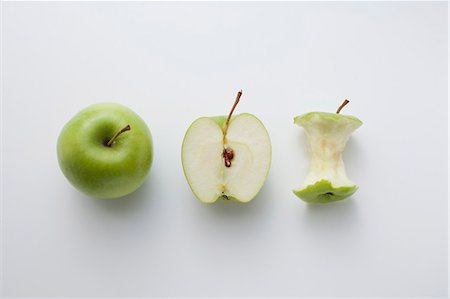 A whole apple, half an apple and an apple core Stock Photo - Premium Royalty-Free, Code: 659-06494083
