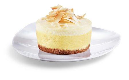 dessert - Mango Citrus Cheesecake with Toasted Coconut; White Background Stock Photo - Premium Royalty-Free, Code: 659-06494108