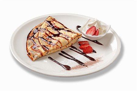 dessert - Crepes with hazelnuts, chocolate, strawberries and soft-serve ice cream Stock Photo - Premium Royalty-Free, Code: 659-06494245