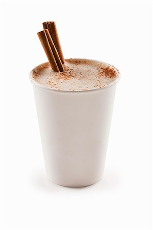 Cinnamon Cappuccino in a Paper Cup with Cinnamon Sticks; White Background Stock Photo - Premium Royalty-Free, Code: 659-06494342