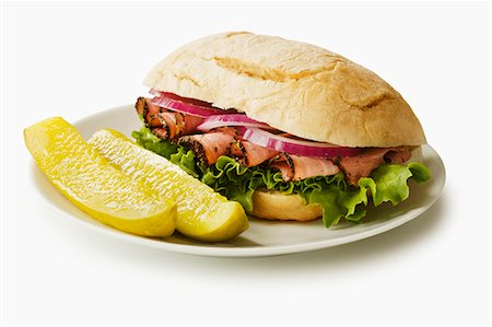 food - Pastrami Sandwich on a Roll with Two Dill Pickle Spears Stock Photo - Premium Royalty-Free, Code: 659-06494469